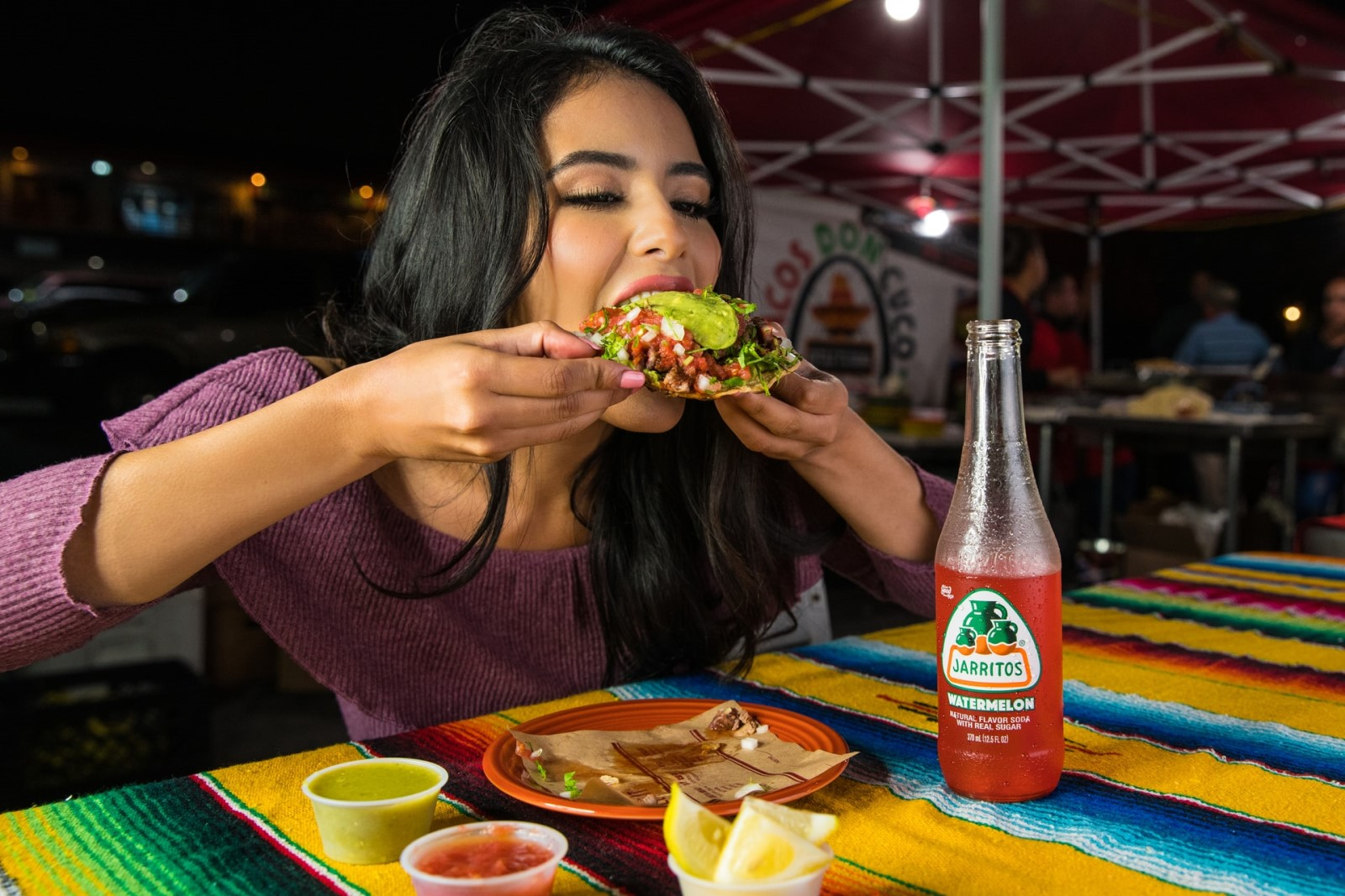 woman-eating-tacos