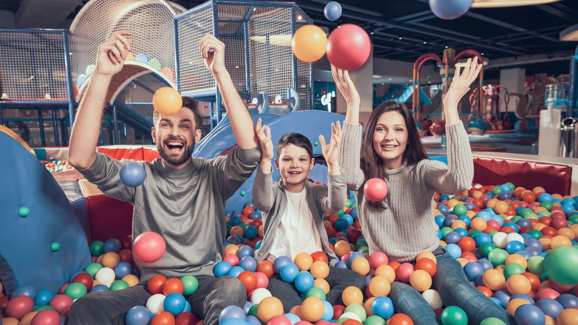 family-playing-in-the-ball-pool
